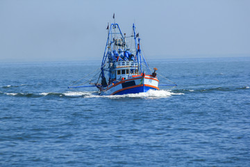 Large fishing boats in the sea.