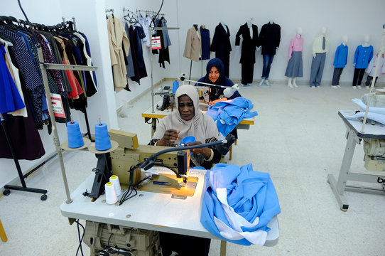 Women work in a sewing workshop supervised by a charity to help widows, divorcees and needy in Benghazi
