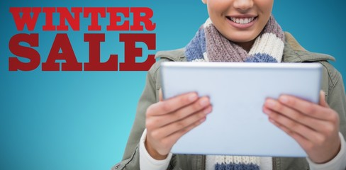 Composite image of composite image of  women holding tablet