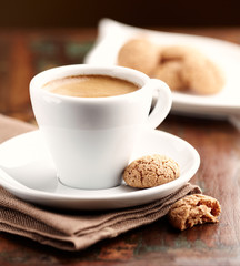 Cup of espresso with biscotti. Symbolic image. Rustic wooden background. Close up.