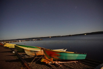 Beach on moonlight with boats