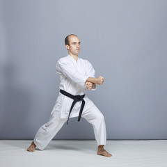 In a karate stand, athlete train formal karate exercises