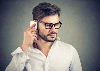 Sad man speaking on a phone