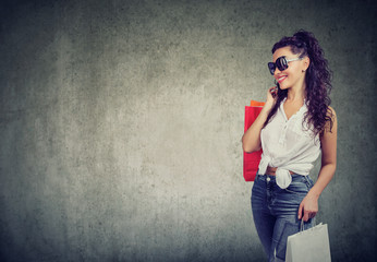 Modern woman with shopping bags