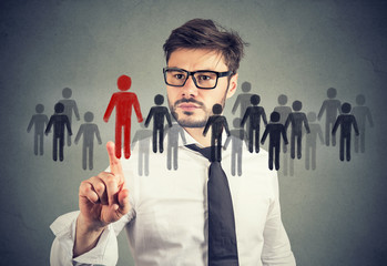 Businessman making a choice for a new job opportunity from a crowd of people