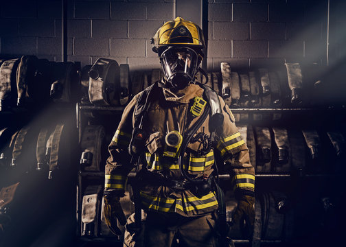 Firefighter wearinf protection clothes and gears