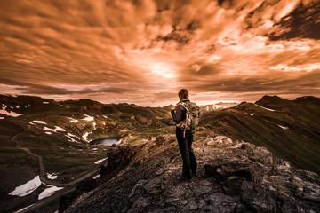 Tourist admires view from California Pass towards lake Como and Poughkeepsie Gulch Vintage Sepia Effect