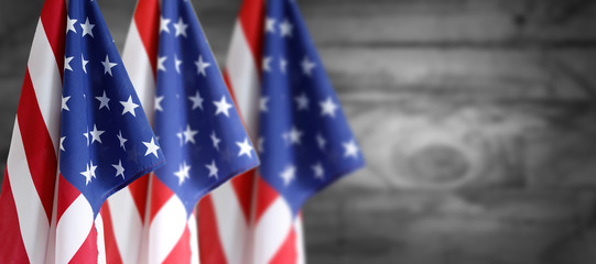 Three American flags and defocused background