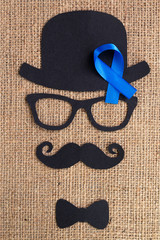 Male silhouette pattern with blue ribbon symbol. November concept.