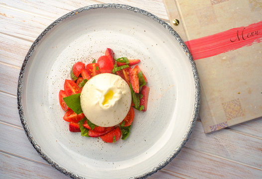 burrata cheese with strawberries in plate