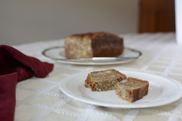 Baked gluten free banana bread on a white plate sitting on a table