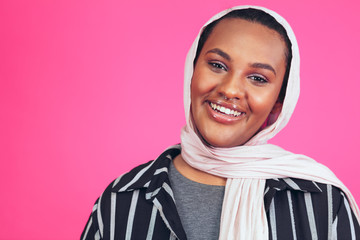 8a6df1408c689 Portrait of smiling young woman with nose ring and headscarf
