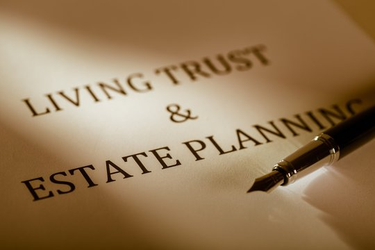 """Fountain Pen Lying on the """"Living Trust and Estate Planning"""" -"""