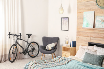 Modern apartment interior with bicycle near window