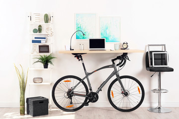 Modern home office interior with bicycle near wall