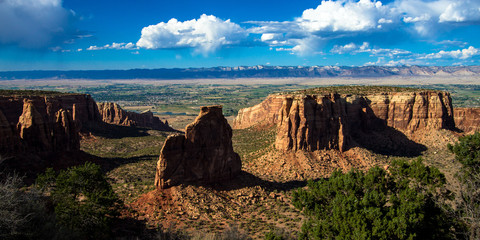 Warm sunset light on the massive formations and high canyon walls of Monument Valley in Colorado National Monument near the town of Fruita
