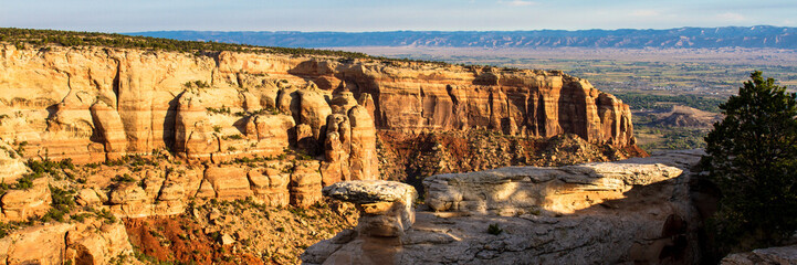 """Early-morning light on the massive 300' high Wingate Sandstone walls of Columbus Canyon from """"Cold Shivers Point"""" at Colorado National Monument"""