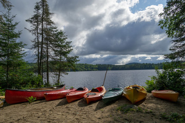 Kayaks and a canoe by the Indian lake in upstate NY (USA)