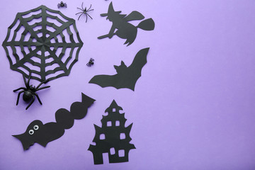 Paper halloween decorations on purple background