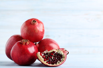 Ripe and juicy pomegranate on wooden table Wall mural