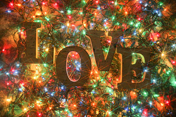 Love written with chrismas lights as a background