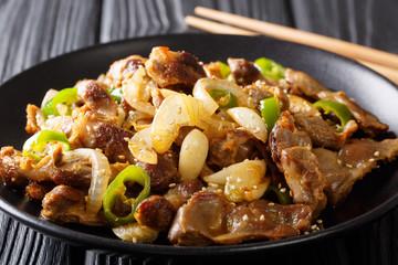 Chicken Gizzard Stir-fry - Dak Ddong Jjip is a Korean dish close-up on a plate. horizontal