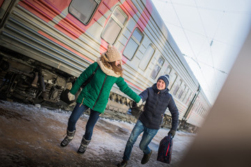 Couple is late for the train at railway station