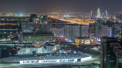 Aerial skyline of Abu Dhabi city centre from above night timelapse