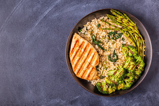 Grilled chicken breast with brown rice, spinach, broccoli, asparagus