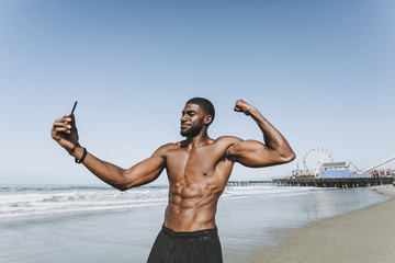 Fit man taking a selfie by Santa Monica Pier