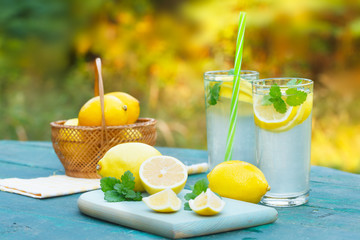 Lemonade or mojito cocktail with lemon and mint, cold refreshing drink or beverage for summer days
