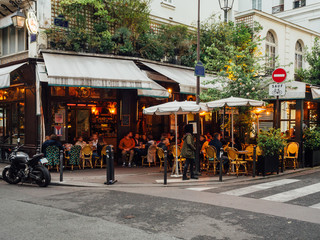 Zelfklevend Fotobehang Centraal Europa Cozy street with tables of cafe in Paris, France