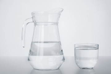A pitcher and a glass. Pure water.