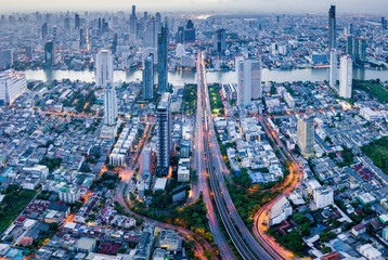 Fototapete - Aerial view of Bangkok skyline panorama and skyscraper with light trails on Sathorn Road center of business in Bangkok city Thailand.