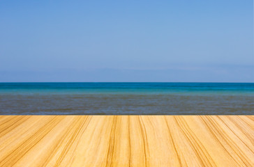 perspective wooden floor texture and blue sea background.