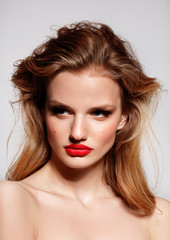 Red lips. Young model girl with beauty skin and blonde hair style. Perfect make up.