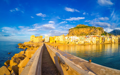 Cityscape of Cefalu at sunset. Romantic scene on the coast of Sicily island, Italy