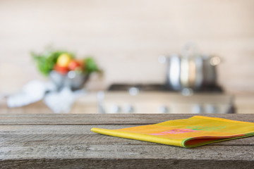 Blurred background. Modern kitchen with empty wooden tabletop and space for you.