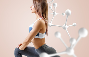 Athletic fitness woman standing near white molecule chain.