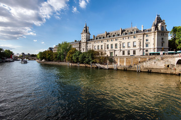 Paris, France - August 13, 2017. View of Conciergerie Palace and Prison on Cite island from Seine. Popular french landmark located on the west of the ile de la Cite, presently used for law courts.