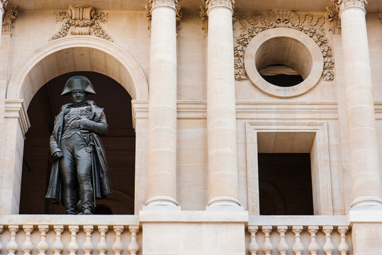 Paris, France - August 13, 2017. Les Invalides Napoleon Bonaparte 1st Statue and attic window in the court of honor in courtyard of Army Museum.