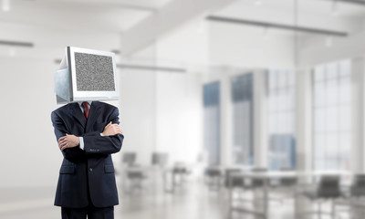 Businessman with monitor instead of head.
