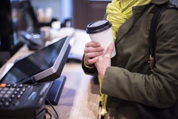 woman ordered coffee take away