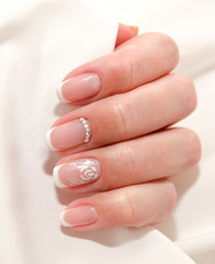 Woman's nails with beautiful french manicure fashion design