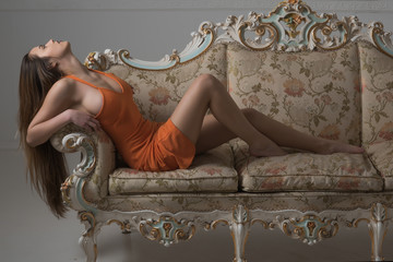 Sensual woman relax on fashionable sofa. Always Love to be fashionable