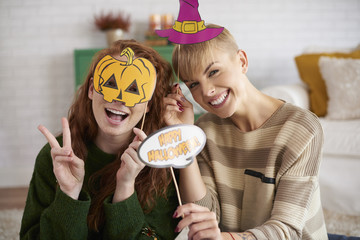 Happy friends with halloween masks