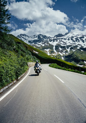 Motorcyclists on serpentine mountain road