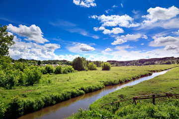 Summer season river landscape. Picturesque Ukrainian village