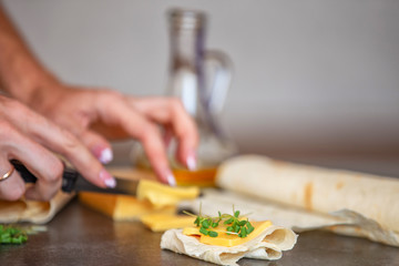 cheese, sunflower oil and thin pita bread lies on a gray stone background