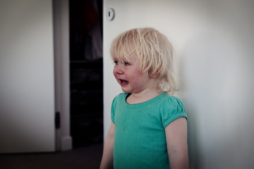 crying child at home, pain, stress, sadness, despair